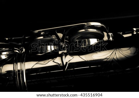 Saxophone alto jazz music instrument close up some light and shadow isolated on black    - stock photo