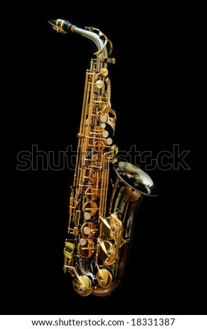 Saxophone isolated in black background - stock photo