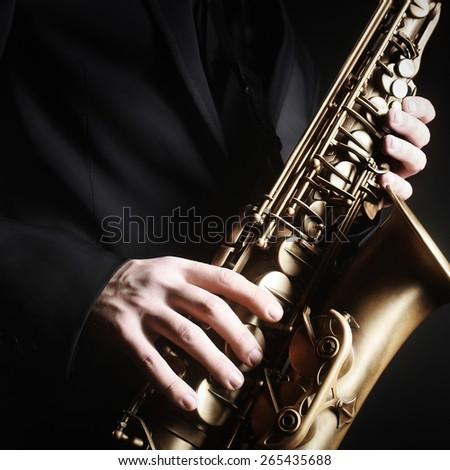 Saxophone jazz music instrument Alto sax saxophonist hands Closeup saxophone player - stock photo