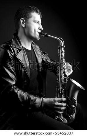 saxophone player fully entranced into his own tunes