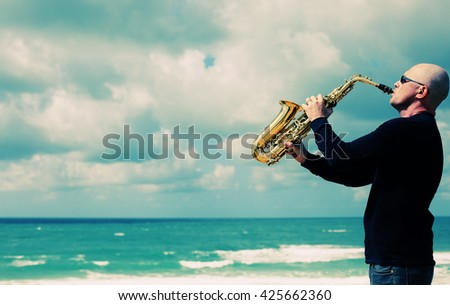 Saxophonist playing on saxophone outdoor