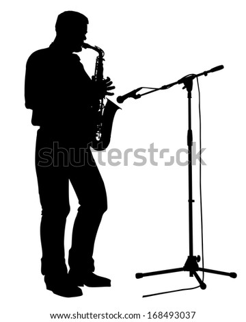 Saxophonist stands on the stage and playing the saxophone.