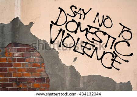 Say No To Domestic Violence - Handwritten graffiti sprayed on wall, anarchist aesthetics. Appeal to against masculinism, violence against women, abuse, rapes and other sexual assault - stock photo