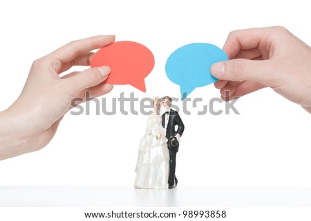 Say yes - wedding figurines (bride and groom) with cartoon bubble hold i hand by real woman and man. - stock photo
