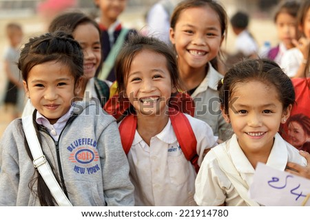 SAYABURI, LAOS, FEBRUARY 16, 2012 :Happy Loatian little girls posing in the schoolyard during the Elephant festival in Sayaburi, Laos - stock photo