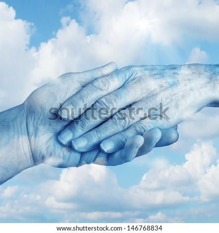 Saying goodbye mourning and grief concept with the hand of a young person letting go an elderly senior who is in the final terminal stages of life as a symbol of heaven and emotional feelings. - stock photo