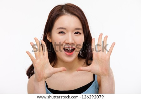 Saying young asian woman isolated on white background.