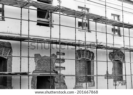 Scaffolding around historic building during the renovation - stock photo