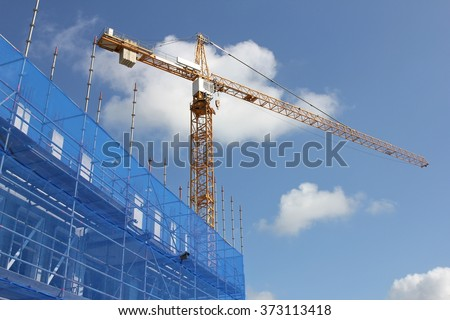 scaffolding at building currently under construction - stock photo