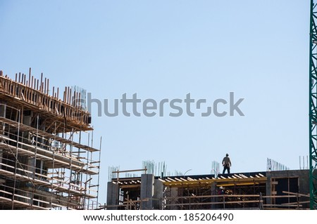 Scaffolding at the construction site of a new building. Construction site background. - stock photo