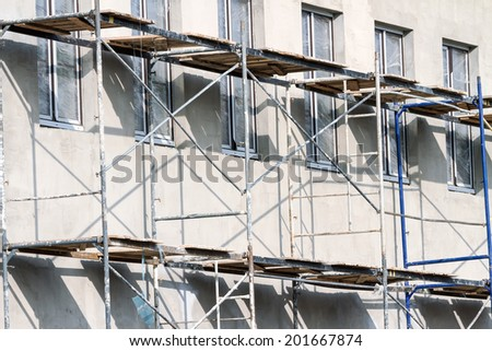 Scaffolding on a building used for renovation and construction - stock photo