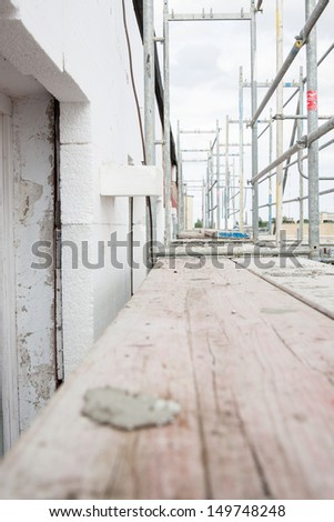 Scaffolding on apartment building  - stock photo
