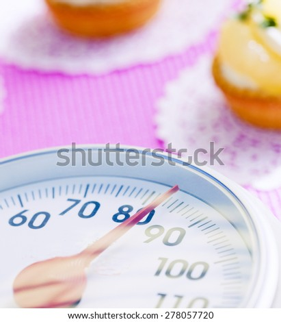 scale and cake - stock photo