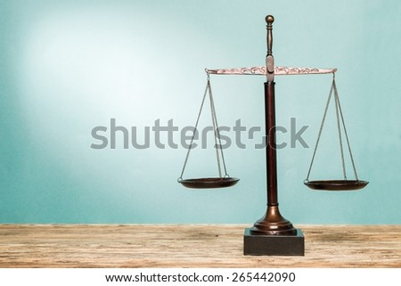 Scale. Law scales on table. Symbol of justice - stock photo