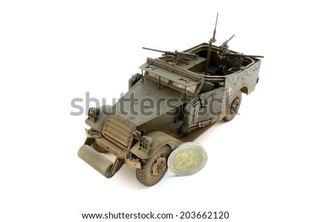 Scale model M3 Scout Car with coin - stock photo