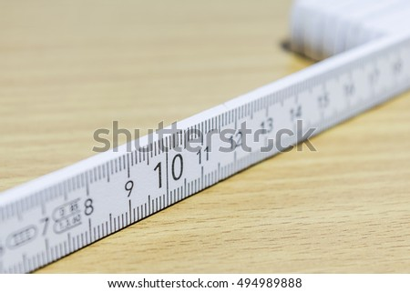 Scale number ten on wooden white ruler