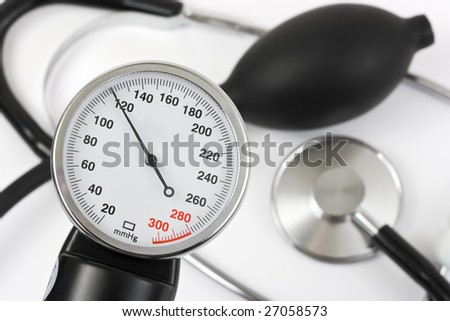 Scale of pressure and stethoscope, abstract medical background - stock photo