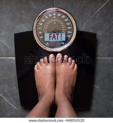scale says you're fat - stock photo