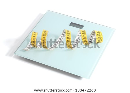 Scale with a tape measure isolated on a white background - stock photo