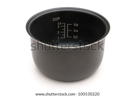 scaled inner pot of electric rice cooker with clipping path - stock photo