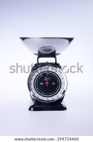 scales for kitchen or black kitchen scales. - stock photo