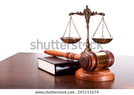 Scales, gavel and book on a table - stock photo