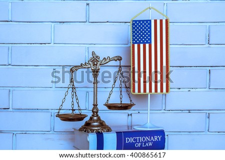 Scales of Justice, american flag, dictionary of law on the brick wall background, BLUE TONE