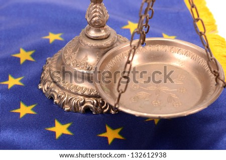 Scales of justice and Flag of European union flag, European union law concept - stock photo