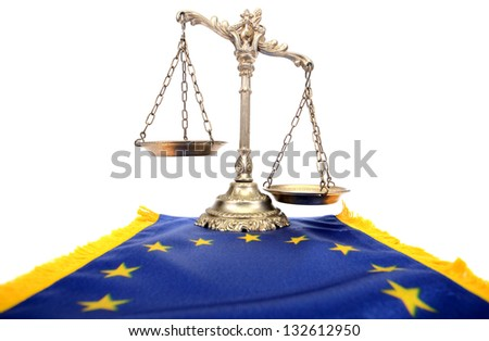 Scales of justice and Flag of European union flag, European union laws - stock photo
