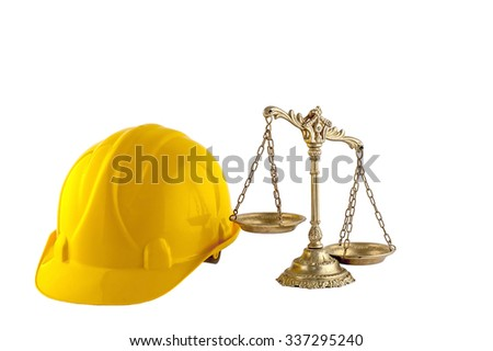 scales of justice and yellow helmet isolated on white background, concept of industry law - stock photo