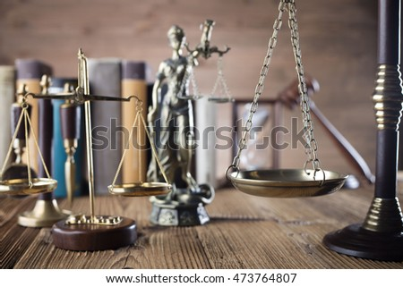 scales of justice, gavel and books on brown background. Law code