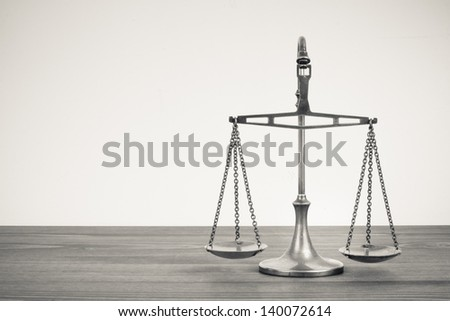 Scales on a table. Vintage sepia photo - stock photo