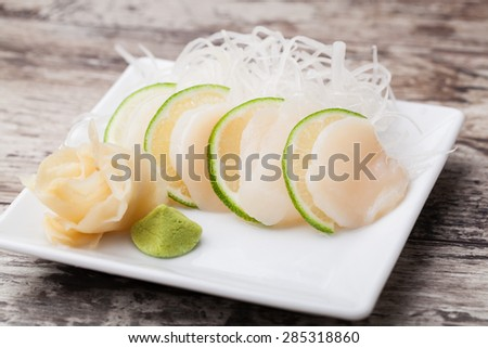 scallops sashimi with withe plate - stock photo