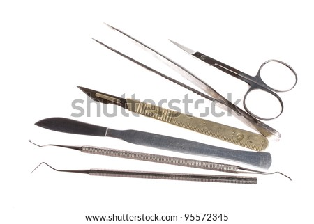 scalpel and other medical instruments isolated on white, no shadow