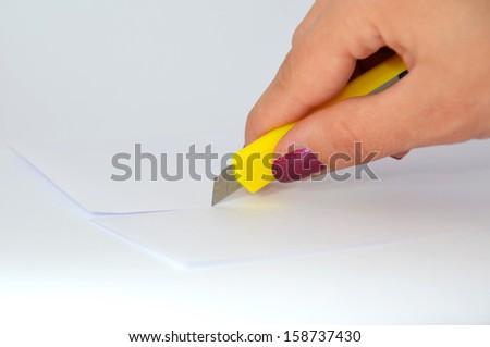 Scalpel cut paper - stock photo