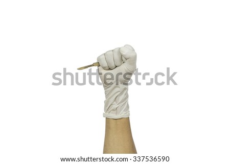 Scalpel in a hand with rubber glove isolated white background - stock photo
