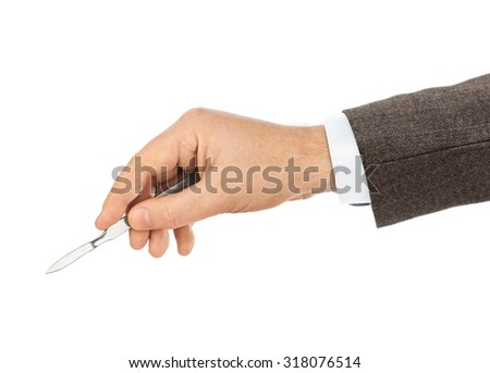 Scalpel in doctor hand isolated on white background - stock photo