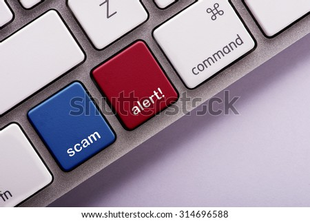 Scam Alert button on white computer keyboard - stock photo