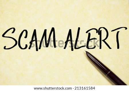 scam alert text write on paper  - stock photo