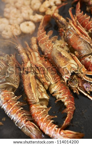 Scampi crabs preparing for meal - stock photo