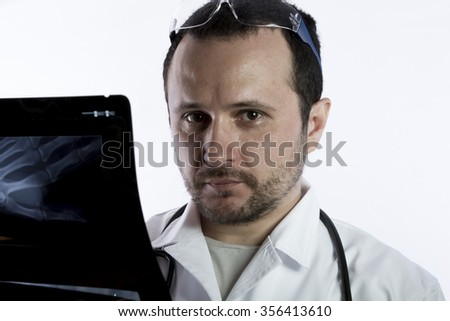 Scan, Radiologist looking at an x-ray in hospital - stock photo