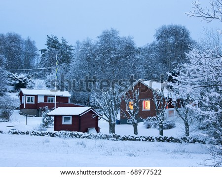 Scandinavian brick house in snowy landscape - stock photo