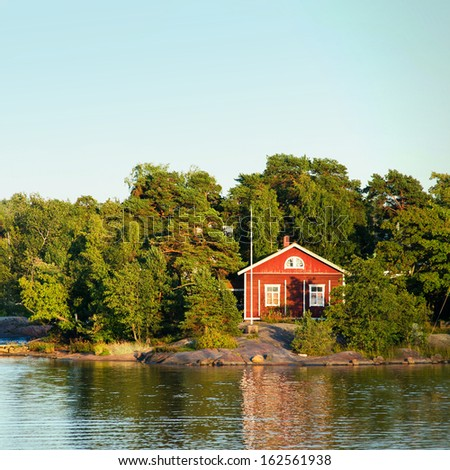 Scandinavian fisherman Red House on sea - stock photo