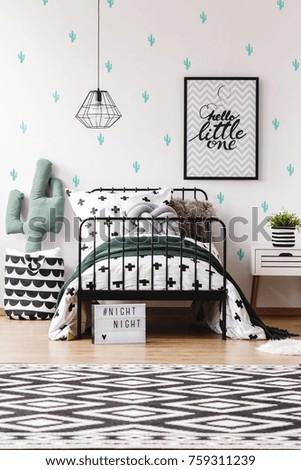 scandinavian style kids bedroom cactus pillow stock photo (edit now