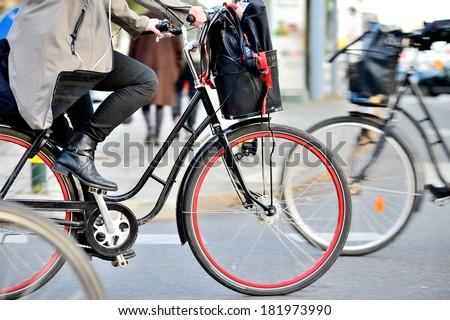 Scandinavian woman on bike - stock photo