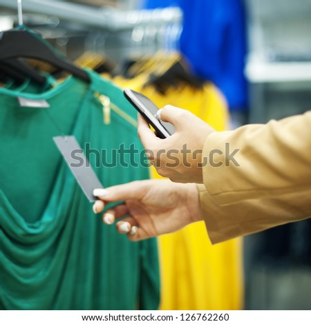 Scanning a QR code in shopping mall - stock photo