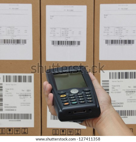 Scanning boxes with barcode scanner operated on smartphone - stock photo