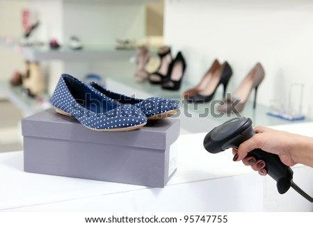 Scanning code on shoe box, cropped view - stock photo