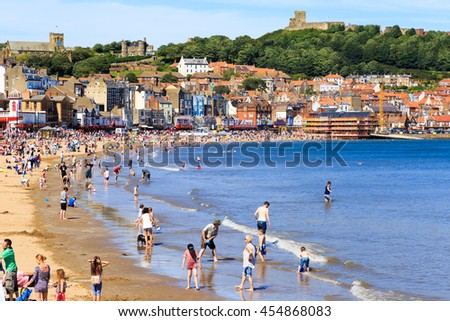 SCARBOROUGH, ENGLAND - JULY 16: Lots of people enjoying Scarborough beach on a hot summer day. In Scarborough, North Yorkshire, England. On 16th July 2016.