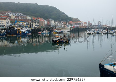 SCARBOROUGH, ENGLAND - SEPTEMBER 2014: Small fishing boat entering Scarborough harbour. 19th September 2014, in Scarborough fishing harbour, England.